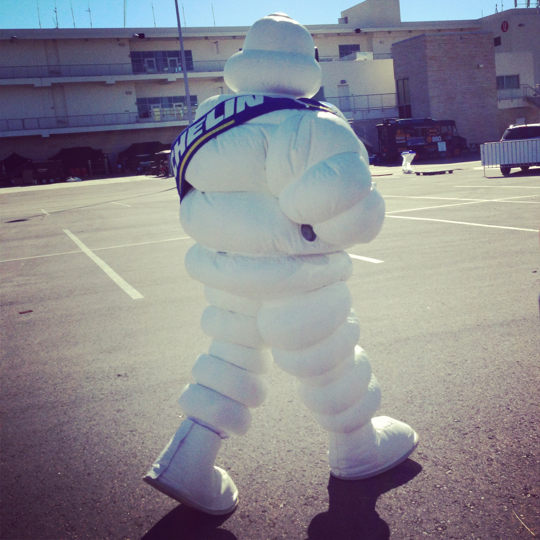The Michelin Man heads to the COTA podium to help the winning drivers celebrate.