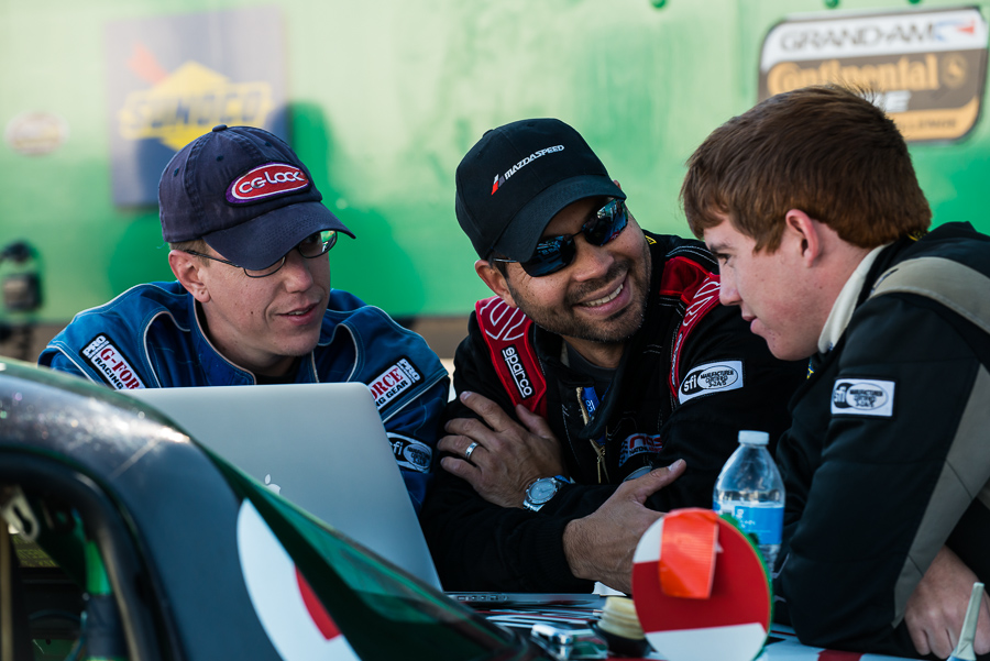 The whole point: drivers at the VIR 13-hour smile as they discuss post-practice data. (Image (c) Steve Romine)