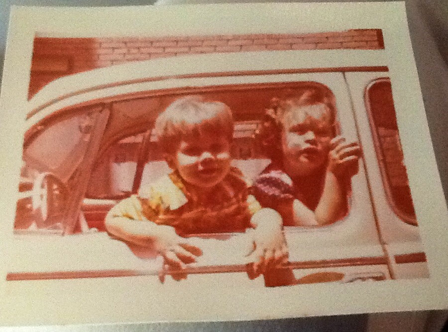 Hanging out in Grandpa's '66 VW Beetle, foreshadowing our driving lessons.