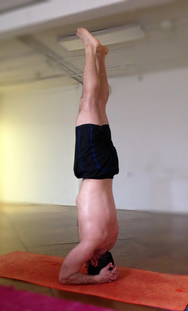 My husband practicing salamba sirsasana (headstand) at the end of his weekly yoga practice.