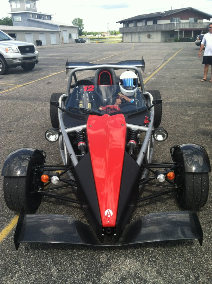 My husband giving charity rides in our friend's banshee, aka the Ariel Atom.