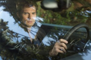 """My tastes [in cars] are very singular."" (still from Fifty Shades of Grey)"